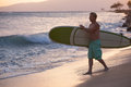 Surfer Walking Surfboard to Water Royalty Free Stock Photo
