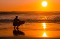 Surfer watching the waves a at sunset in portugal Royalty Free Stock Photos