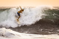 Surfer on wild Ocean Wave in Bali Royalty Free Stock Photo