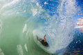 Surfer Wipe Out Inside Hollow Wave Stock Image