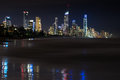 Surfers paradise at night with crashing waves on the beach Stock Photo