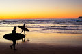 Surfers at sunset, Portugal Royalty Free Stock Photo