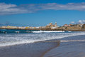 Surfers on the windy beach of cadiz spain Stock Photography