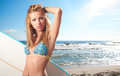 Surfing beautiful woman on the beach Royalty Free Stock Images