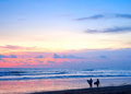 Surfing couple beach of surfers walking on the on bali island indonesia Royalty Free Stock Photo