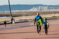 Surfing dad son walking durban beaches and down the beach promenade going for a morning surf at a beach south africa between the Stock Photo