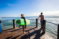 Surfing girl boy waves pier jump surfers and ready to into ocean off to surf morning ocean at surf city durban south africa Stock Photography