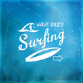 Surfing label on meshes background with stains Royalty Free Stock Images