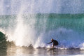 Surfing rider escape danger action straightens out on a large hollow wave to wipe out Stock Photography