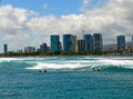 Surfing waikiki surfers in with modern buildings in the background Stock Photos