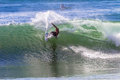 Surfing wave carve turn surfer carves a on clean in morning light at bay of plenty beach in durban Stock Photo