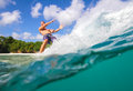 Surfing a wave underwater viewing bali indonesia Stock Photo