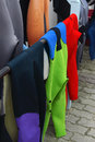 Surfing wetsuits are drying in the sun after the lesson Royalty Free Stock Image