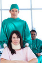 Surgeon carrying a patient on a wheelchair Royalty Free Stock Photos