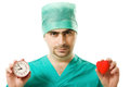 The surgeon with a clock and a heart Royalty Free Stock Image