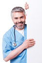 Surgeon with copy space confident mature looking out of the white poster and smiling while standing isolated on white Stock Photo