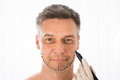 Surgeon Drawing Correction Lines On Man Face Royalty Free Stock Photo