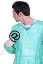 Surgeon with email symbol Royalty Free Stock Photography