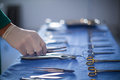 Surgeon holding surgical tool in operation theater Royalty Free Stock Photo