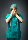 Surgeon mistery doctor with uniform expression and emotions Stock Photography
