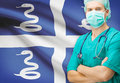 Surgeon with national flag on background series martinique Royalty Free Stock Photography