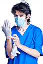 Surgeon struggle into gloves on hands Stock Image