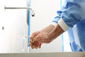 Surgeon washing hands the doctor washes his disinfect their before surgery Royalty Free Stock Image