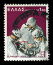 Surgeons performing surgery vintage postage stamp Royalty Free Stock Images