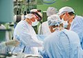 Surgeons team at operation of surgeon in uniform perform on a patient cardiac surgery clinic Royalty Free Stock Photo