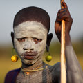 Suri boy with face painting and earrings at a ceremony in south omo ethiopia Stock Images