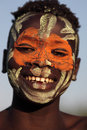 Suri boy with face painting smiling at a ceremony in south omo ethiopia Royalty Free Stock Photography