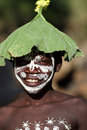 Suri boy with flower decoration smiling and face painting at a ceremony in south omo ethiopia Stock Photography