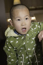 Surprise boy chinese with mouth open Stock Photo