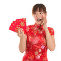 Surprise chinese cheongsam girl holding red packets asian woman with traditional dress or qipao ang pow or packet monetary gift Royalty Free Stock Images