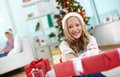 Surprise for christmas portrait of cheerful girl with red giftbox looking at camera on evening Stock Photo