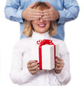 Surprise concept man giving present to his wife Royalty Free Stock Image