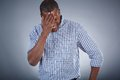 Surprise image of young african man touching his head in Royalty Free Stock Photography