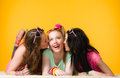 Surprise kiss three girls girlfriends give a Royalty Free Stock Photo