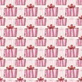Surprise repeating pattern. Holiday wrap paper design with pink giftboxes Royalty Free Stock Photo