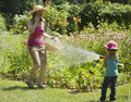 Surprise water fun in the garden Royalty Free Stock Photo