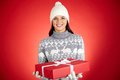 Surprise for you portrait of happy girl in winterwear holding red giftbox and looking at camera Royalty Free Stock Images
