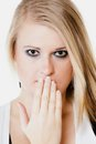 Surprised afraid girl covering mouth with hand body language and emotions blonde shocked young woman isolated on white Royalty Free Stock Photos