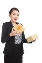 Surprised Asian business woman open a golden gift box Royalty Free Stock Photo