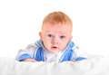 Surprised baby boy lying on the white blanket Royalty Free Stock Photo