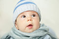 Surprised baby looking up in blue Stock Photography