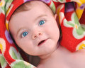 Surprised Baby in Red Blanket Stock Images