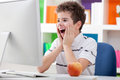 Surprised boy with computer Royalty Free Stock Photo
