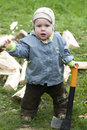 Surprised boy with wood chopper Royalty Free Stock Image