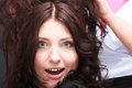 Surprised brunette woman open mouth wide eyed in hair salon portrait of schoked beautiful women with by hairdressing hairdresser Stock Photography