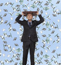 Surprised businessman and flying dollar banknotes against blue sky Stock Images